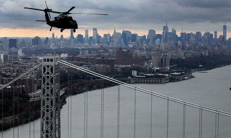 A New York National Guard helicopter surveys the city during the storm.