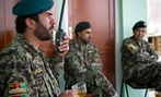 Afghan National Army Lt. Col. Abdul Wakil Warzejy, left, gives orders on his radio at his base in Logar province.