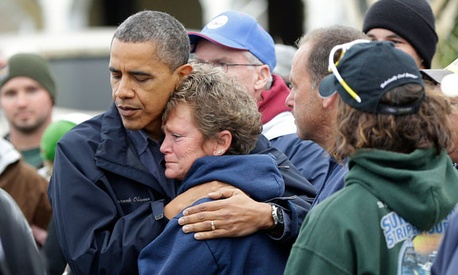 Obama embraces Donna Vanzant in Brigantine, N.J., during a tour assessing the damage in the state Wednesday.