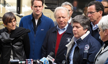 Homeland Security Secretary Janet Napolitano, right, speaks at a news conference with Connecticut lawmakers after touring storm-damaged areas.