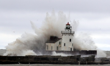 Waves pound a lighthouse as Hurricane Sandy hits the shores of Lake Erie, Tuesday.