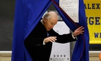 Vice President Joe Biden exits a voting booth after casting his ballot in Greenville, Del.