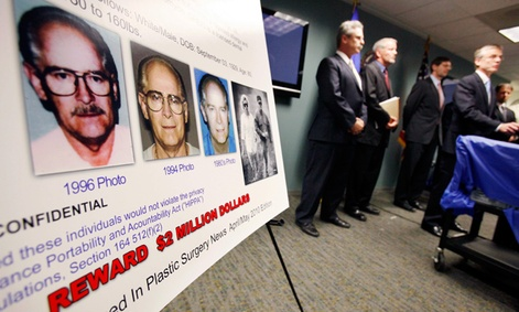 "FBI special agent Richard Deslauriers, right, speaks during a news conference about their hunt for fugitives James ""Whitey"" Bulger and Catherine Greig in 2011.  The FBIs facial recognition app would help identify criminal suspects in the field."