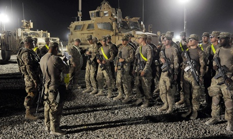U.S. soldiers from the 4th Brigade, 82nd Airborne arrive to a yard where they will turn in their vehicles and equipment as part of drawdown of 23,000 U.S. troops at the Kandahar Air Field south of Kabul, Afghanistan. 