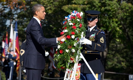 Obama laid a wreath at the Tomb of the Unknown Soldier at Arlington Cemetery Sunday.