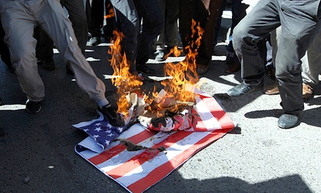 A mock U. S. flag set on fire by a group of about 50 angry Islamists, who were shouting anti-U.S. slogans and protesting against a film ridiculing the Prophet Muhammad near the U.S. embassy in Ankara, Turkey.