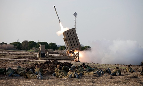 Israeli soldiers lie on the ground as an Iron Dome missile is launched near the city of Ashdod, Israel, Monday Nov 19. 2012.