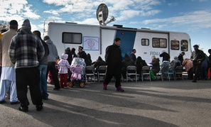 New Yorkers wait for assistance from a FEMA trailer on Coney Island after Sandy hit the area.