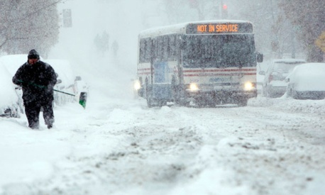 A bus navigates the streets during a snowstorm in Washington, DC in 2009.
