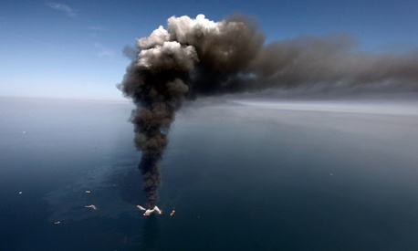 A large plume of smoke rises from fires on BP&#39;s Deepwater Horizon offshore oil rig. 