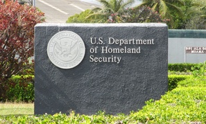 A sign directs visitors to a Homeland Security office in Hawaii.