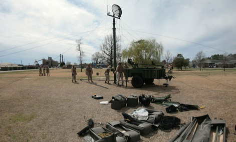 Marines set up a M142C radio attached to the Tactical Elevated Antennae Mast System antenna during a training exercise held aboard Camp Lejeune, N.C., in 2010.