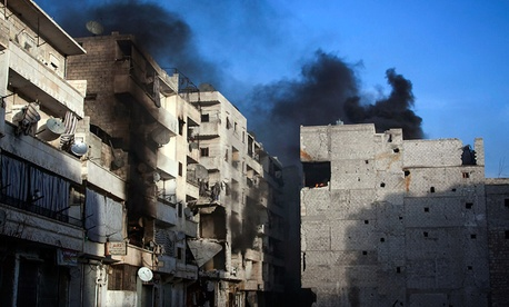 Smoke rises from residential buildings due heavy fighting between Free Syrian Army fighters and government forces in Aleppo, Syria.