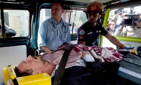 Software company founder John McAfee lies inside an ambulance, to be transferred from an immigration detention center to a hospital, in Guatemala City.