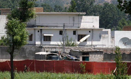 A Pakistani soldier stands near a compound where Osama bin Laden lived in Abbottabad, Pakistan.