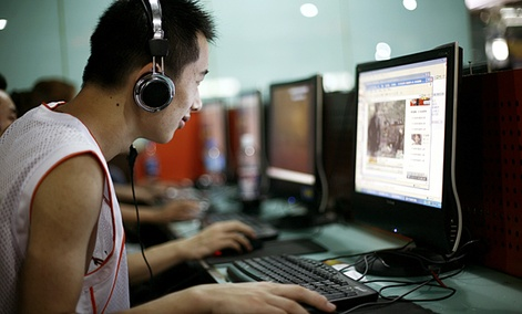 A visitor at an Internet cafe in Beijing surfs the web.