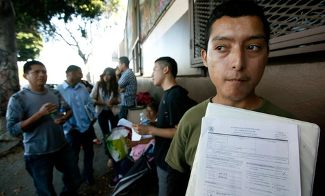 Illegal immigrant Layios Roberto waits with papers outside the offices of Coalition for Humane Immigrant Rights in Los Angeles Wednesday, Aug. 15, 2012.