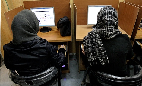 Iranian women use computers at an Internet cafe in central Tehran, Iran.