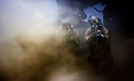 A still from the film shows SEALs during the mission.
