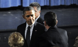 President Barack Obama greets Gov. Dannel Malloy during his arrival at the start of an interfaith vigil for the victims of the Sandy Hook Elementary School shooting on Sunday, Dec. 16, 2012 at Newtown High School in Newtown, Conn.