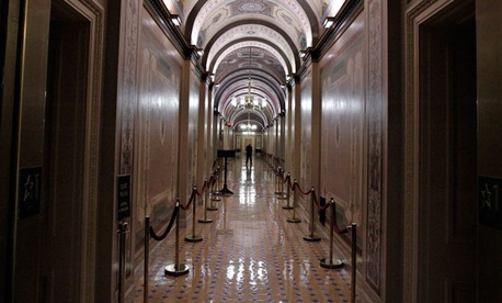 The Brumidi Corridors of the United States Capitol are mostly empty during recess.