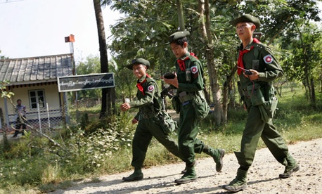 Myanmar soldiers patrol close to Sin Thet Maw relief camp.