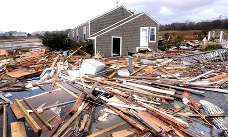 Debris floats around a house pushed off it's foundation in the aftermath of superstorm Sandy.