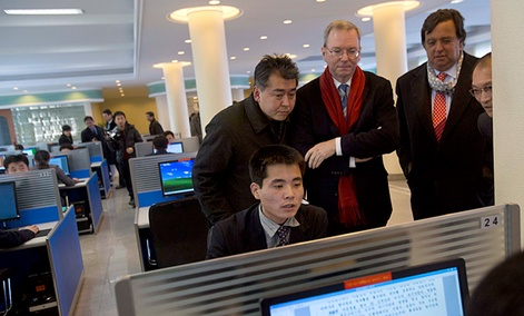 Executive Chairman of Google, Eric Schmidt, third from left, and former New Mexico governor Bill Richardson, second from right, watch as a North Korean student surfs the Internet.