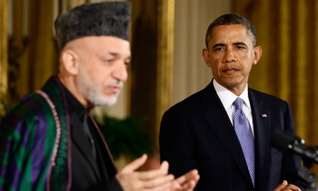 President Barack Obama listens to Afgan President Hamid Karzai 