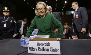 Secretary of State Hillary Clinton gets ready to testify Wednesday on Capitol Hill.