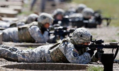 Female soldiers from the 1st Brigade Combat Team, 101st Airborne Division train on a firing range in Fort Campbell, Ky.