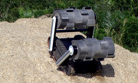The RASSOR robot climbs a hill during recent testing at NASA&#39;s Kennedy Space Center in Florida. 