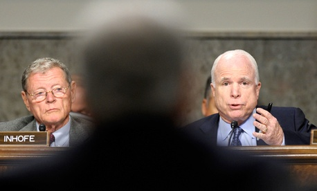 Sen. John McCain, R-Ariz., right, asks a question of former Nebraska Sen. Chuck Hagel.