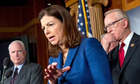 "Sen. Kelly Ayotte, R-N.H., center, responds to a reporter's question with House Armed Services Committee Chairman Howard ""Buck"" McKeon, R-Calif., right, and Sen. John McCain, R-Ariz."