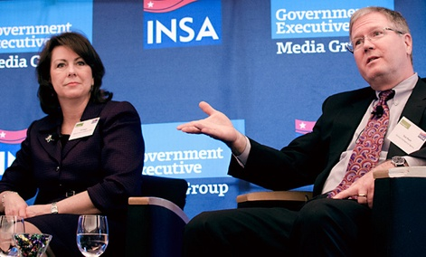 National Reconnaissance Office CIO Jill Singer, left, and CIA Chief Information Officer Gus Hunt at a forum hosted by Nextgov and INSA