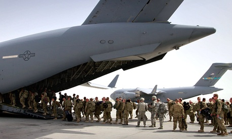 U.S. soldiers get in to a U.S. military plane, as they leave Afghanistan, at the U.S. base in Bagram, north of Kabul, Afghanistan.