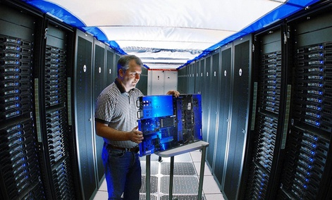 A Sandia reseracher inspects a Thunderbird supercomputer component. 