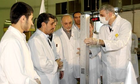 Iranian President Mahmoud Ahmadinejad, second left being escorted by technicians during a tour of Tehran&#39;s research reactor center in northern Tehran, Iran.