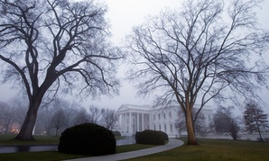 Fog envelopes the White House in December.