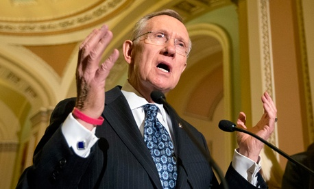 Senate Majority Leader Harry Reid, D-Nev., answers questions on the looming automatic spending cuts following a Democratic strategy session at the Capitol in Washington.