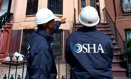 OSHA inspectors work in Brooklyn, New York.