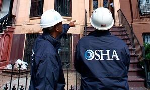 OSHA inspectors work in Brooklyn, New York.