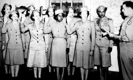 Women Army Auxiliary Corps members are sworn into the Women's Army Corps at Fort Custer, Mich., in 1943