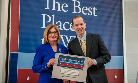 Left, NCUA Chairman Debbie Matz accepting the Best Places to Work in the Federal Government award for most improved mid-size agency from Max Stier, president and CEO of the Partnership for Public Service.
