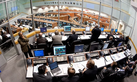 NASA mission managers work in Firing Room Four of the Launch Control Center at NASA Kennedy Space Center.