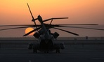 The sun rises over a CH-53E Super Stallion in Afghanistan in 2010