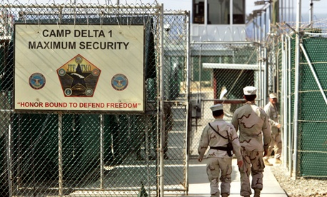US military guards walk within Camp Delta military-run prison, at the Guantanamo Bay US Naval Base.