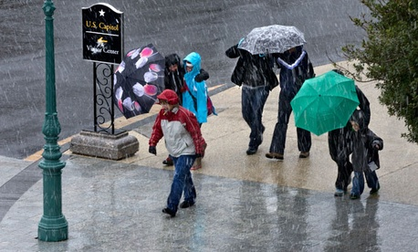 High winds and a mix of rain and snow battered Washington Wednesday.