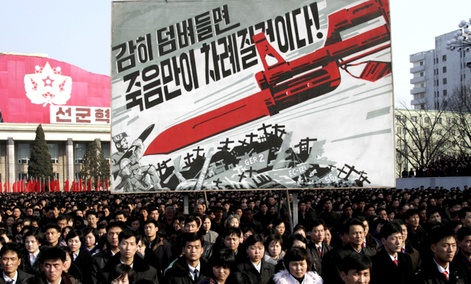 North Koreans attend a rally to support a statement given on Tuesday by a spokesman for the Supreme Command of the Korean People's Army vowing to cancel the 1953 cease-fire that ended the Korean War.