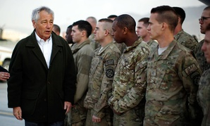 U.S. Secretary of Defense Chuck Hagel greets U.S. Army troops on the tarmac of Kabul airport in Afghanistan.